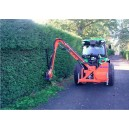 Ryetec Sl side arm flail hedge cutter with fingerbar head on leylandi