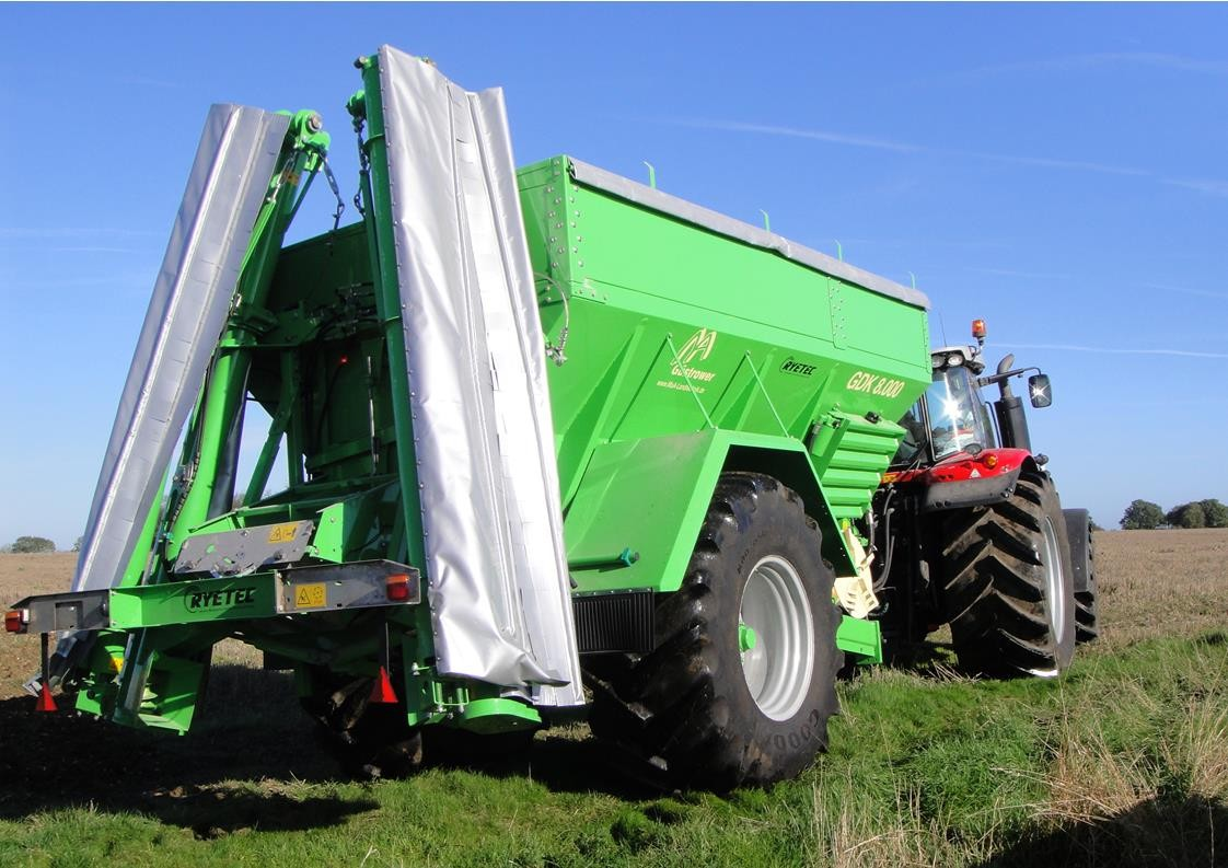 Ryetec Gustrower Lime spreader with auger screw boom folded for transport